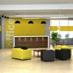 Strefa recepcyjna w żółto-czarnej kolorystyce z nowoczesną ladą recepcyjną oraz niskimi fotelami dla gości